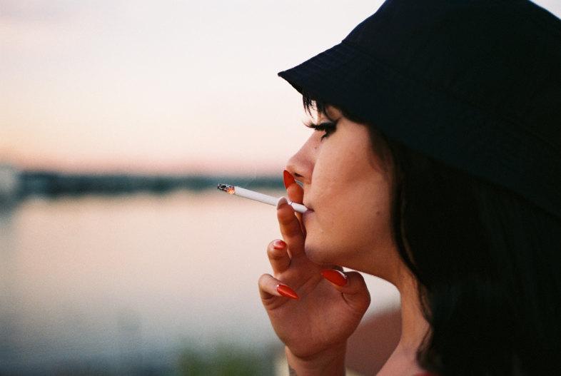 woman smoking classic cigarette