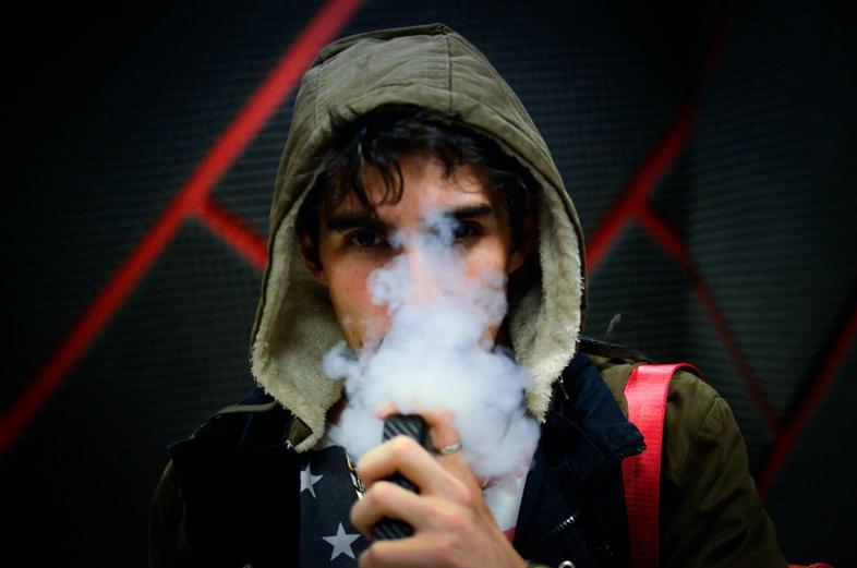 young man smoking e cig