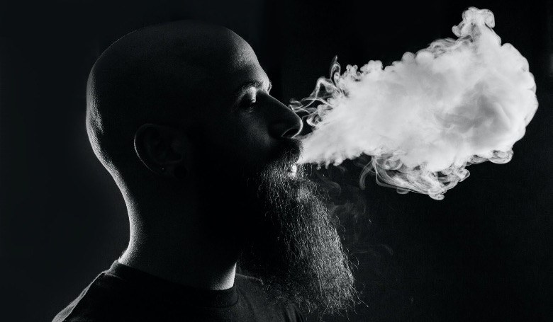 Man starting to use electronic cigarette
